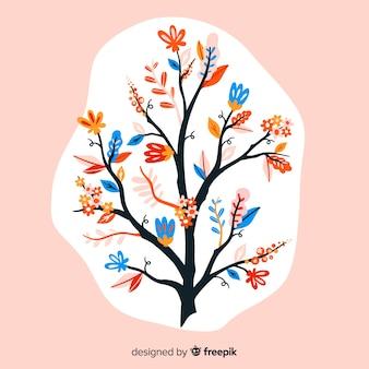 Composición con flores en flor y ramas en una mancha blanca