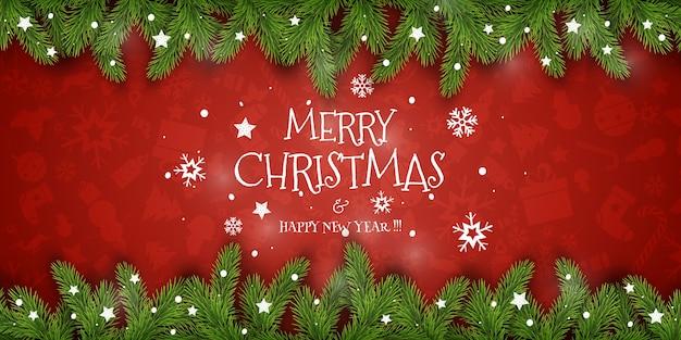 Composición navideña. deseos de vacaciones sobre fondo rojo con ramas de abeto. para saludar