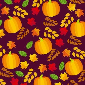 Composición otoñal de hojas y calabazas