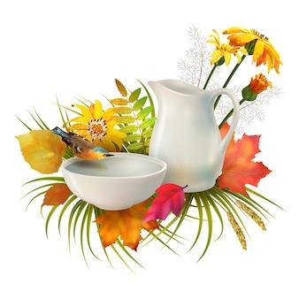 Composición de otoño con una jarra, un pájaro bebiendo agua de un cuenco de barro, flores y hojas de otoño sobre fondo blanco.