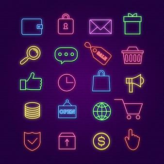 Compras iconos de neón. comercio electrónico, intercambie letreros coloridos con efectos luminosos. almacene el carro, el dinero, la caja y los símbolos de iluminación de la insignia de venta en la pared de ladrillo. luz de resplandor de neón, ilustración de iconos de comercio