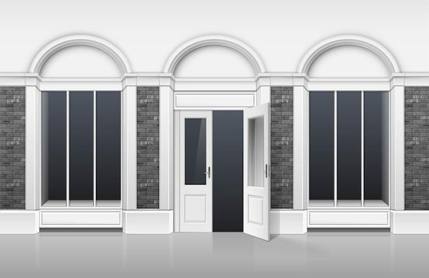 Compre boutiqu con escaparate de windows, puerta abierta