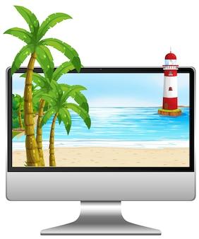 Computadora en la mesa con playa en pantalla