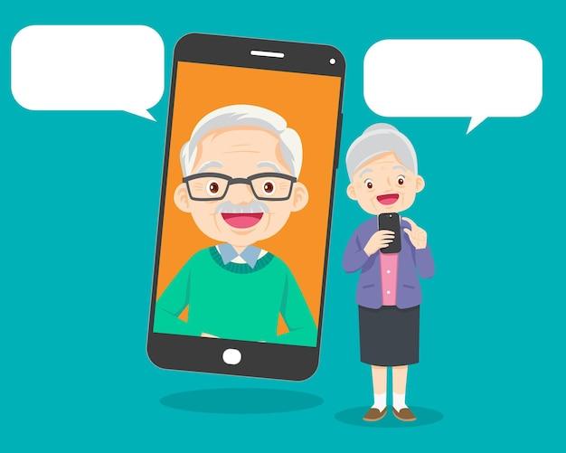 Comunicación de pareja de ancianos mediante videollamada de abuela y abuelo de teléfono inteligente