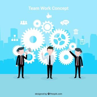 Concepto acerca del trabajo en equipo con un fondo azul