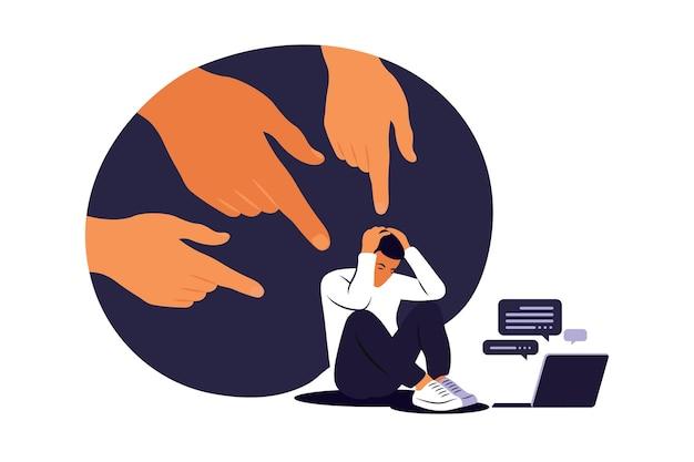 Concepto de acoso cibernético. hombre deprimido sentado en el suelo.