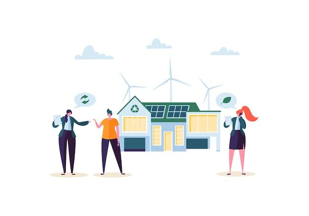 Concepto de casa ecológica con agente de bienes raíces que presenta la casa moderna a los clientes. ecología energía verde, solar y eólica.