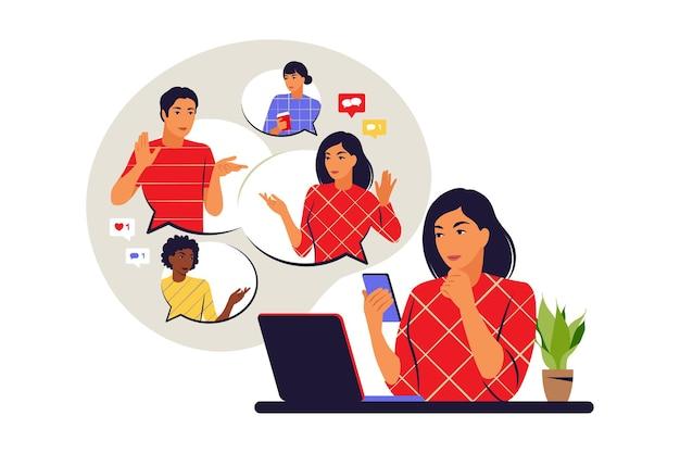 Concepto de chat. mujer en el escritorio charlando con amigos en línea. videoconferencia conceptual, trabajo remoto. ilustración vectorial. plano.