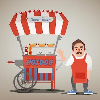 Concepto de comida callejera con carrito de hot dog y vendedor