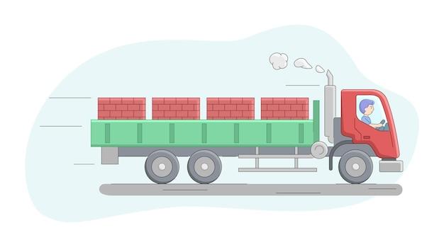 Concepto de construcción. camión furgoneta con plataforma cargada por ladrillos sobre paletas. trabajador montando camión. trabajos de operador de maquinaria de construcción. personaje masculino en el trabajo.