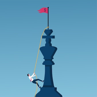 Concepto de crecimiento profesional y objetivo empresarial. empresario escalar un ajedrez rey en una cuerda para lograr el éxito