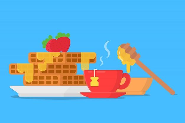 Concepto de desayuno waffles con miel y taza de té