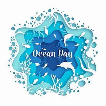 Concepto del día mundial de los océanos en papel con pescado