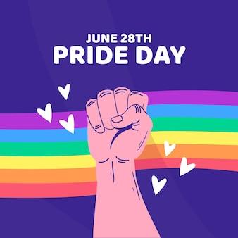 Concepto del día del orgullo con puño y arcoiris