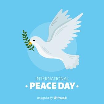 Concepto del día de la paz con paloma dibujada a mano