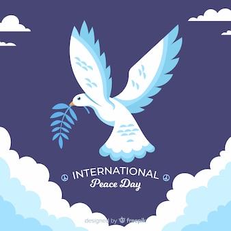 Concepto del día de la paz con paloma de diseño plano