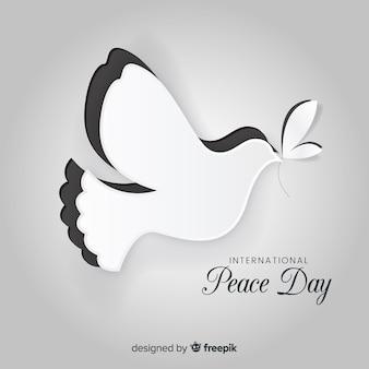 Concepto del día de la paz con papel dover