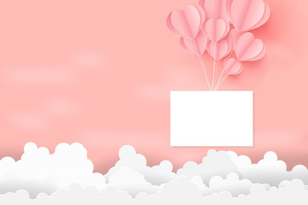 El concepto del día de san valentín con los globos de los corazones flota en el cielo.