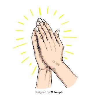 Concepto dibujado a mano de manos rezando