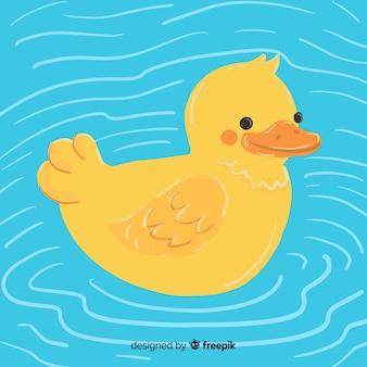 Concepto de dibujos animados con pato de goma amarillo