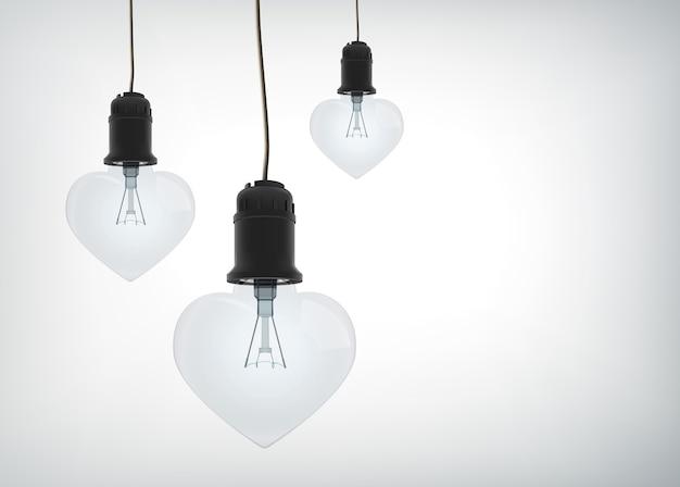 Concepto de diseño amoroso ligero con bombillas eléctricas realistas en forma de corazón colgando de cables aislados
