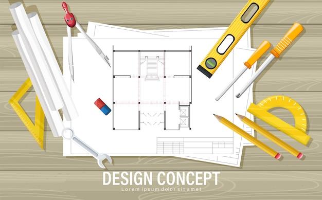 Concepto de diseño de planos con herramientas de arquitecto en mesa de madera