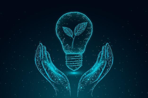 Concepto de ecología tecnológica con mano y bombilla