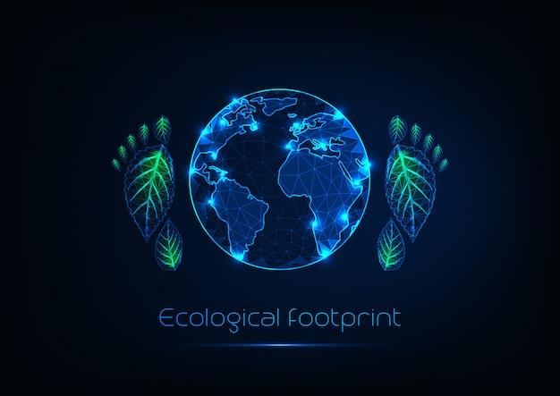 Concepto de huella ecológica con brillo futurista bajo el planeta tierra poligonal y huellas humanas.