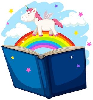 Concepto de libro de unicornio y arco iris