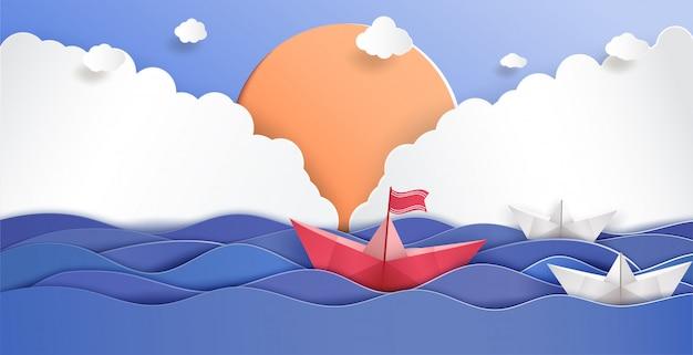 Concepto de liderazgo y origami hecho en barco de papel rojo.