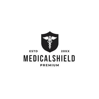 Concepto de logotipo de escudo médico con símbolo de farmacia y escudo