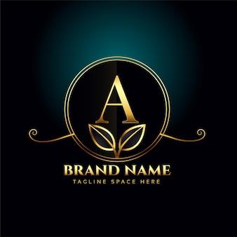 Concepto de logotipo de lujo letra a con hojas doradas