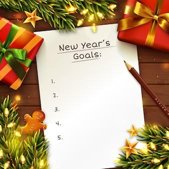 Concepto de metas de año nuevo con hoja de papel. mesa de madera decorada con caja de regalo, ramas de árboles de navidad y guirnaldas de luces.
