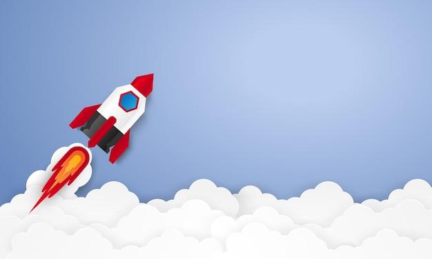 Concepto de puesta en marcha con cohete con espacio en blanco i estilo de arte en papel