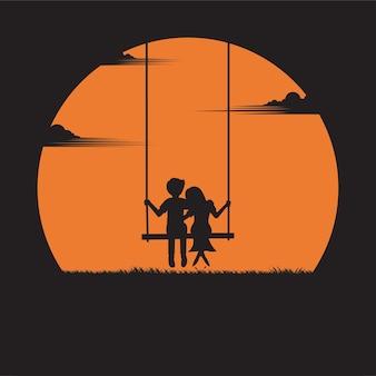 Concepto de san valentín. pareja sentada en un columpio bajo el fondo del atardecer