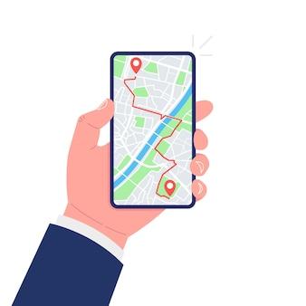 Concepto de seguimiento y navegación gps móvil. mano que sostiene el teléfono inteligente con la ruta del mapa de la ciudad y la marca de ubicación en la pantalla.