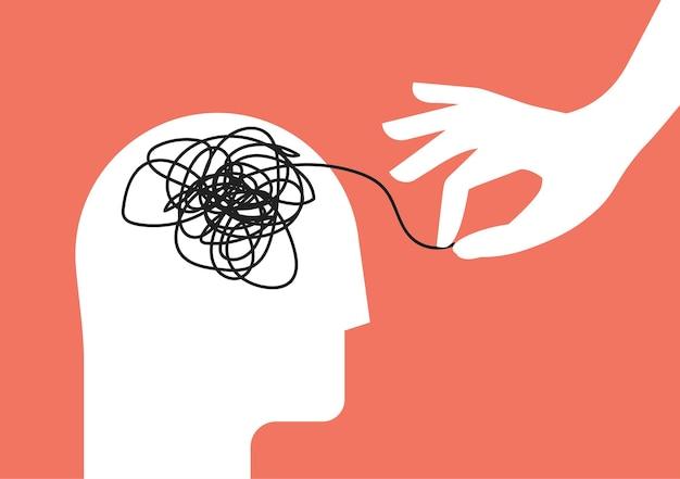 Concepto de sesión de terapia psicológica con silueta de cabeza humana y mano amiga que desenreda la maraña de pensamientos desordenados con trastorno mental, ansiedad y confusión, mente o estrés