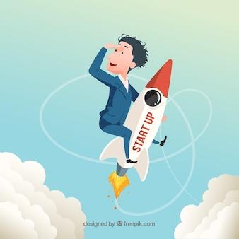 Concepto de start up con cohete y hombre de negocios