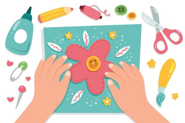 Concepto de taller creativo de bricolaje con manos haciendo flores