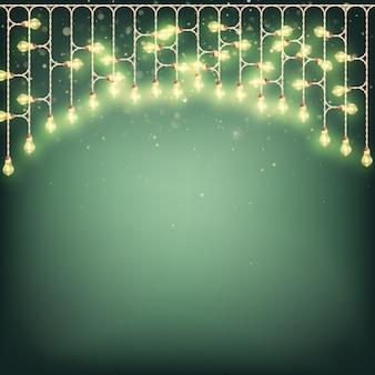 Concepto de tarjeta de feliz navidad - guirnalda de luces brillantes.