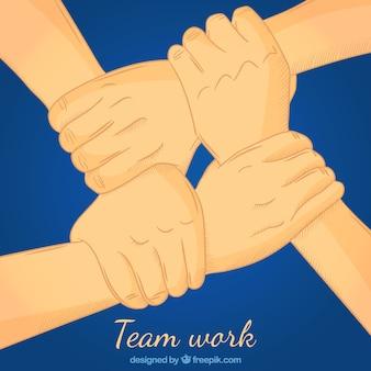 Concepto de teamwork con manos cogiéndose