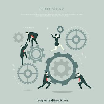 Concepto de teamwork con ruedas de engranaje y gente de negocios