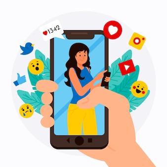 Concepto de teléfono móvil de marketing en redes sociales con emoticones