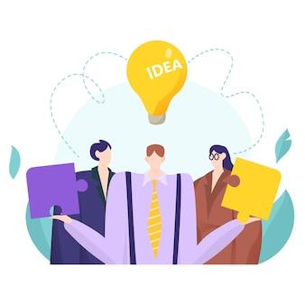 Concepto de trabajo en equipo con empresario sosteniendo piezas de rompecabezas creativos