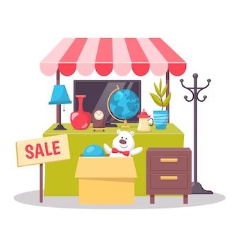 Concepto de venta de garaje con artículos