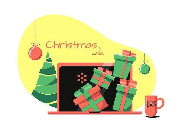 Concepto de venta de navidad en línea los regalos asoman desde un portátil de pie sobre la mesa