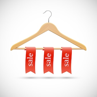 Concepto de venta: perchas de madera con cintas rojas