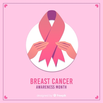 Conciencia del cáncer de mama con cinta y manos