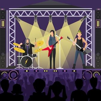 Concierto de artistas del grupo pop en escena.