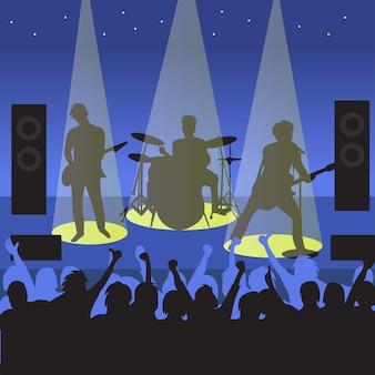 Concierto de banda de música por la noche